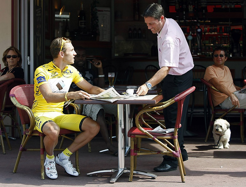 AG2R La Mondiale rider and race leader Rinaldo Nocentini of Italy is served coffee during a photo session  in Limoges