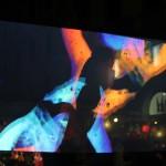 """Ilaria Vergani, Paolo di Giacomo """"Musica Pop. L'arpa"""" Una video proiezione in cui la corda di un'arpa fende lo spazio. Una mano la pizzica, diffondendo   nell'aria una nota speciale."""